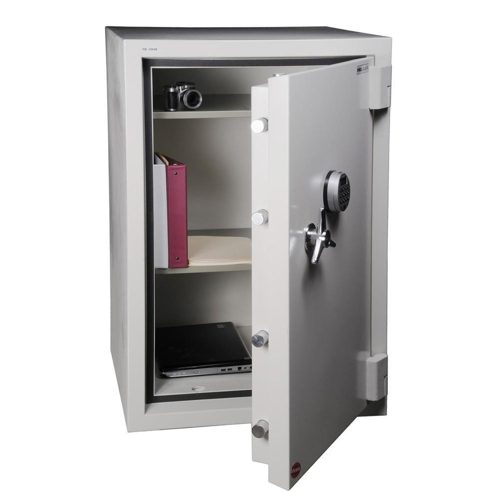 A commercial safe with its door open containing documents, a laptop computer, and a camera